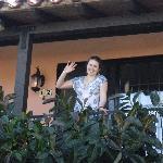 Liz waving near rubber tree