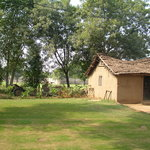 Traditional Rajasthani mud cottage with a thatched roof.
