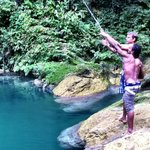Blue Hole!  Jahvier teaching my husband to use the rope swing
