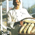 "Andre ""hand-makes"" his own crusty bread each Friday morning."