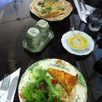 Lunch of salmon quiche and salad and chicken,asparagus and cheese melt
