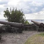 Cannons with Middle Cay and West Cay visible in the distance