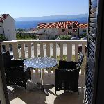 our apartment balcony with table and 2 chairs - what a wanderful view!