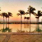 Sunset at the infinity pool by the beach