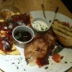 sharing platter with still frozen potato filled skins - yuck !