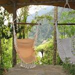The swinging chairs overlooking the river Pastaza