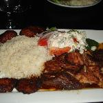 pork should braised in bolivian beer w aji panco (a pepper)--a bolivian jerk pork, plantains, ri