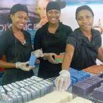 Staff showing our coconut oil hand  milled soap