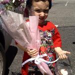 My son with bday flowers and cupcake by Nadia for his girlfriend lol