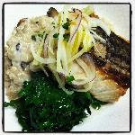 Wild striped bass with mushroom, risotto, kale, & citrus fennel slaw.