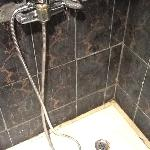 Shower recess, with hot water turned on at maximum