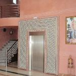 The elevator and staircase in the lobby. Be prepared to carry all your own luggage.