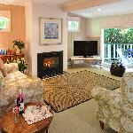 Stables Cottage lounge with log fire