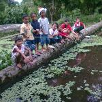 Farm kids catching our fresh lunch in a pond dug by  students from HK