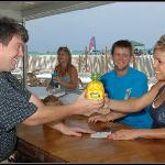 Enjoy a tropical drink in the Tiki Bar right on the beach