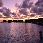 Sunrise over the jetty (villas/Dhoni suites at right of jetty surrounding lagoon)