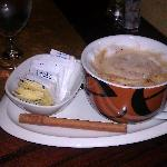 A luxurious and silky cappucino / the cinnamon stick was a fabulous touch