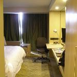 work desk and bed from entry corridor