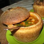 the famous bean soup with smoked ham served in bread