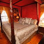 Mrs. Beal's Suite. Four poster, antique, hand carved  canopy bed.