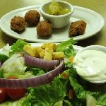 Side salad with hush puppies and pickled green tomatoes