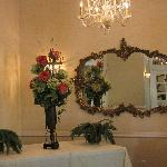 Chandeliers, flowers and ornate mirrors are part of the private room