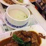 Braised pork (foreground), dry noodles (background)