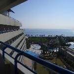 View from balcony, ocean, fussball field, some pools