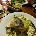 My sea bass with seafood sauce; fish n'chips in the background
