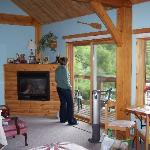 Sunny Rock B&B Waterwindsong Riverview Suite with sitting area, steam shower, sitting deck, and