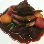 local lamb loin with farm vegetables and harvested berries