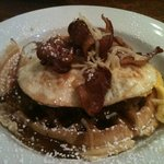 southwest chicken & waffles w/ ancho chili maple syrup, smoked Gouda, crispy bacon.