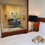 Superior room with view of the bathroom through the glass wall