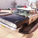 Andy's squad car parked out front.