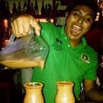 Friendly bartender serving up tamarind margaritas