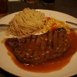 Medium rare steak with spaghetti and sweetcorn with peppercorn sauce