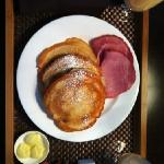 In-Room Dining: Buttermilk & Blueberry Pancakes. Choice of Nueske's Ham or Applewood Smoked Baco