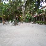 Sandy courtyard. Rooms in a horseshoe around
