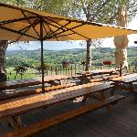 Open air sitting area overlooking the farm, hills, and San Gimignano