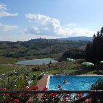 View of the pool, Tuscan hills, and San Gimignano from the dining area