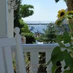 Take in a glimpse of the bay from the porch of our Provincetown B&B