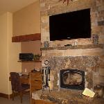 Flagstone wood-burning fireplace and desk area in Chimayo Suite