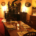The antique wood stove in the Dining Room