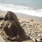 Mermaid sand sculpture along Malecon