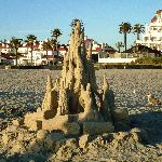 A sand scupture of a bonfire on the beach in front of the hotel.
