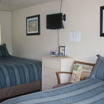 Unit #2 with a queen bed, a full bed and a sofa (not pictured).