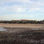 Beach, with hotel behind, the stones are only to that side of beach at lowtide