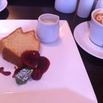 Lemon drizzle cake with raspberry coulis