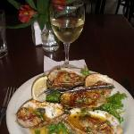 Grilled oyster with piquant salsa...