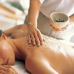 Woman enjoying massage treatment